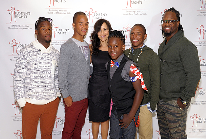 Pictured: Rosie Perez and the Parrish family