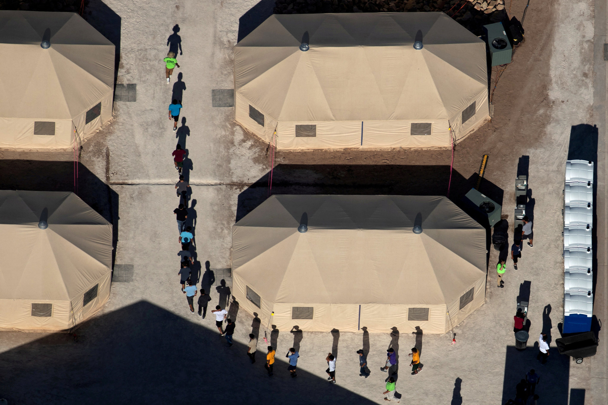 Migrant Children Moved to Texas Tent City