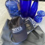 hat, passport and water bottle-blue things